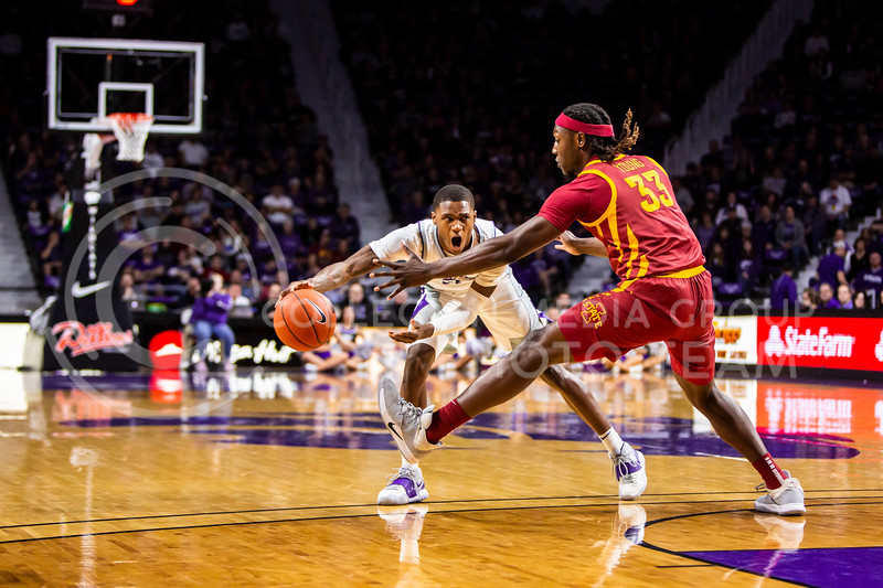 Freshman guard DaJuan Gordon scans the court for an open play during K-State's Senior Day Saturday game against Iowa State in Bramlage Coliseum on March 7, 2020. The Wildcats took the Cyclones 79-63. (Logan Wassall | Collegian Media Group)