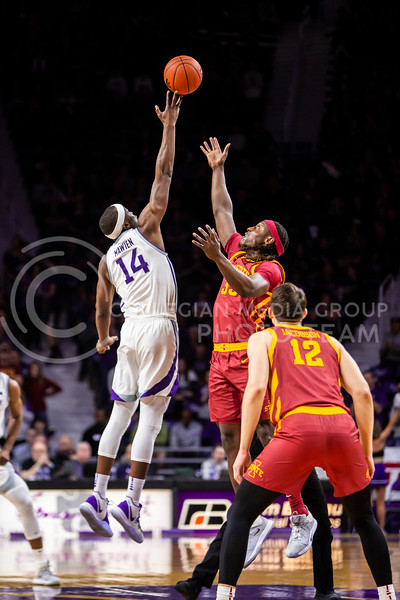 Senior forward Makol Mawein leaps up for the tipoff during K-State's Senior Day Saturday game against Iowa State in Bramlage Coliseum on March 7, 2020. The Wildcats took the Cyclones 79-63. (Logan Wassall | Collegian Media Group)