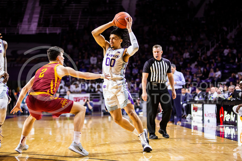 Junior guard Mike McGuirl scans the court for an open play during K-State's Senior Day Saturday game against Iowa State in Bramlage Coliseum on March 7, 2020. The Wildcats took the Cyclones 79-63. (Logan Wassall | Collegian Media Group)