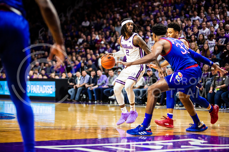 Junior guard Cartier Diarra scans the court for an open play during K-State's men's basketball sunflower showdown against Kansas in Bramlage Coliseum on Feb. 29, 2020. The Jayhawks narrowly beat the Wildcats 62-58. (Logan Wassall | Collegian Media Group)