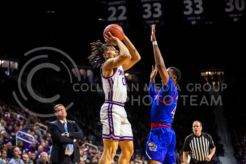 Junior guard Mike McGuirl leaps up for a shot during K-State's men's basketball sunflower showdown against Kansas in Bramlage Coliseum on Feb. 29, 2020. The Jayhawks narrowly beat the Wildcats 62-58. (Logan Wassall | Collegian Media Group)