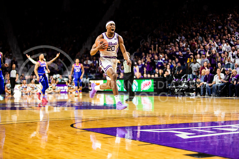 Senior forward Xavier Sneed celebrates after a foul is called during K-State's men's basketball sunflower showdown against Kansas in Bramlage Coliseum on Feb. 29, 2020. The Jayhawks narrowly beat the Wildcats 62-58. (Logan Wassall | Collegian Media Group)