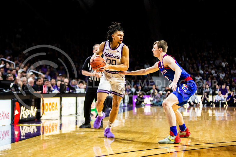 Junior guard Mike McGuirl scans the court for an open play during K-State's men's basketball sunflower showdown against Kansas in Bramlage Coliseum on Feb. 29, 2020. The Jayhawks narrowly beat the Wildcats 62-58. (Logan Wassall | Collegian Media Group)