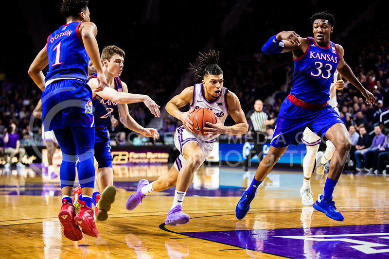 Junior guard Mike McGuirl charges the basket during K-State's men's basketball sunflower showdown against Kansas in Bramlage Coliseum on Feb. 29, 2020. The Jayhawks narrowly beat the Wildcats 62-58. (Logan Wassall | Collegian Media Group)