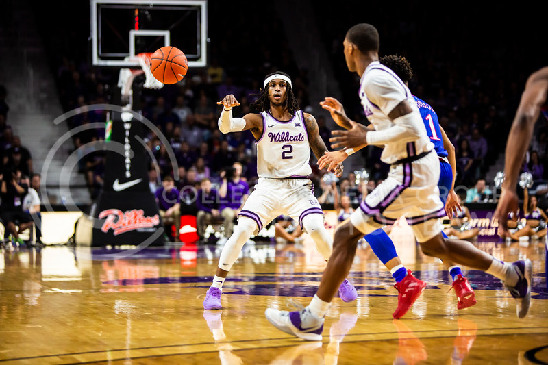 Junior guard Cartier Diarra passes the ball during K-State's men's basketball sunflower showdown against Kansas in Bramlage Coliseum on Feb. 29, 2020. The Jayhawks narrowly beat the Wildcats 62-58. (Logan Wassall | Collegian Media Group)
