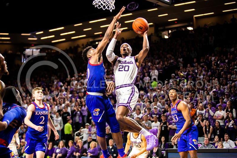 Senior forward Xavier Sneed is fouled as he charges the basket during K-State's men's basketball sunflower showdown against Kansas in Bramlage Coliseum on Feb. 29, 2020. The Jayhawks narrowly beat the Wildcats 62-58. (Logan Wassall | Collegian Media Group)