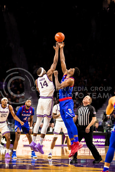 Senior forward Makol Mawein leaps up for the tipoff during K-State's men's basketball sunflower showdown against Kansas in Bramlage Coliseum on Feb. 29, 2020. The Jayhawks narrowly beat the Wildcats 62-58. (Logan Wassall | Collegian Media Group)