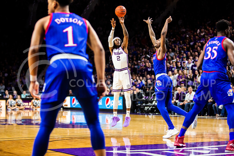 Junior guard Cartier Diarra leaps up for a shot during K-State's men's basketball sunflower showdown against Kansas in Bramlage Coliseum on Feb. 29, 2020. The Jayhawks narrowly beat the Wildcats 62-58. (Logan Wassall | Collegian Media Group)