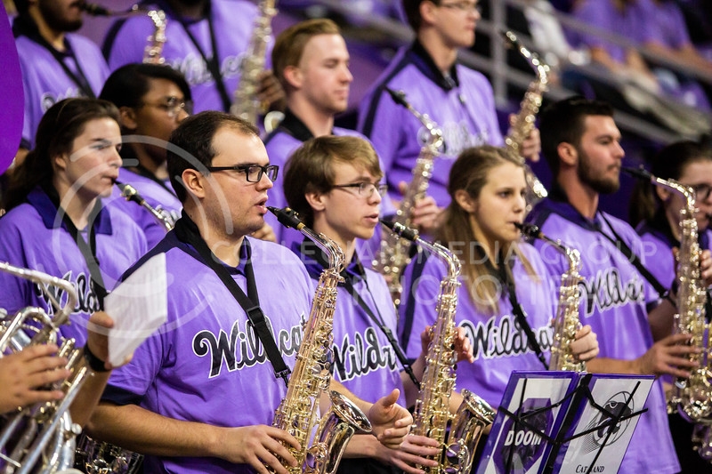 K-State's Cat Band performs before their men's basketball Throwback Game against Texas in Bramlage Coliseum on Feb. 22, 2020. For the Throwback Game, K-State wore two-tone lavender uniforms, which were worn from 1973 to 1982. The Longhorns took the Wildcats 70-59. (Logan Wassall | Collegian Media Group)