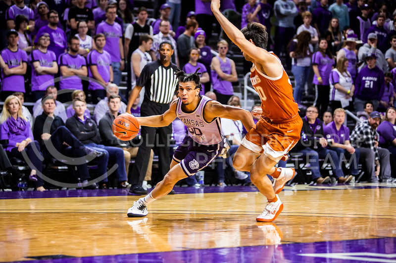 Junior guard Mike McGuirl charges the basket during K-State's men's basketball Throwback Game against Texas in Bramlage Coliseum on Feb. 22, 2020. For the Throwback Game, K-State wore two-tone lavender uniforms, which were worn from 1973 to 1982. The Longhorns took the Wildcats 70-59. (Logan Wassall | Collegian Media Group)