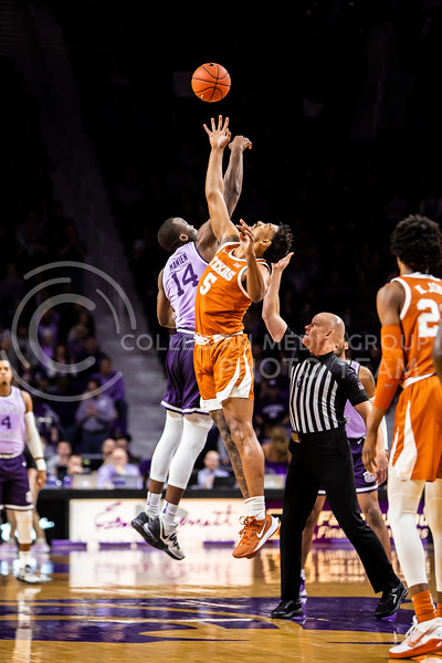 Senior forward Makol Mawein leaps up for the tipoff during K-State's men's basketball Throwback Game against Texas in Bramlage Coliseum on Feb. 22, 2020. For the Throwback Game, K-State wore two-tone lavender uniforms, which were worn from 1973 to 1982. The Longhorns took the Wildcats 70-59. (Logan Wassall | Collegian Media Group)