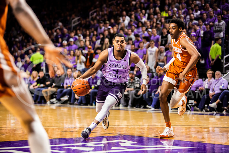 Junior guard David Sloan charges the basket for a shot during K-State's men's basketball Throwback Game against Texas in Bramlage Coliseum on Feb. 22, 2020. For the Throwback Game, K-State wore two-tone lavender uniforms, which were worn from 1973 to 1982. The Longhorns took the Wildcats 70-59. (Logan Wassall | Collegian Media Group)