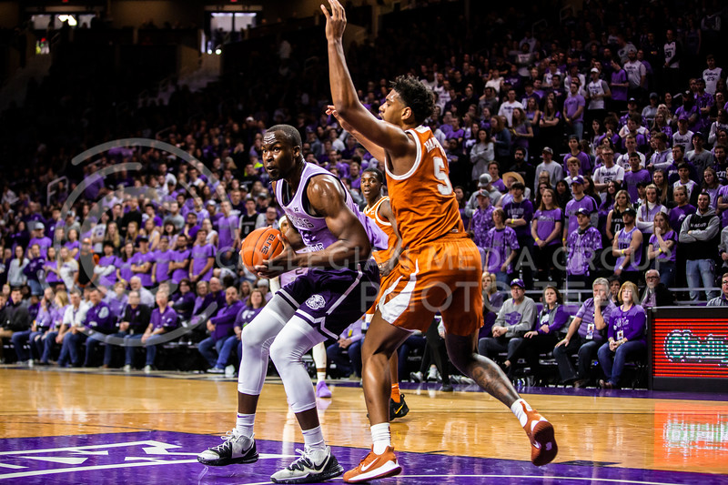 Senior forward Makol Mawein looks towards the basket for a play during K-State's men's basketball Throwback Game against Texas in Bramlage Coliseum on Feb. 22, 2020. For the Throwback Game, K-State wore two-tone lavender uniforms, which were worn from 1973 to 1982. The Longhorns took the Wildcats 70-59. (Logan Wassall | Collegian Media Group)
