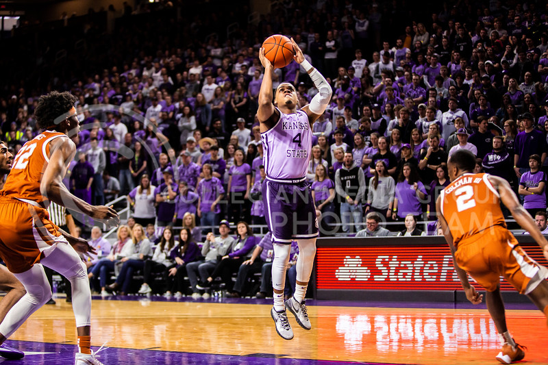 Junior guard David Sloan jumps up for a shot during K-State's men's basketball Throwback Game against Texas in Bramlage Coliseum on Feb. 22, 2020. For the Throwback Game, K-State wore two-tone lavender uniforms, which were worn from 1973 to 1982. The Longhorns took the Wildcats 70-59. (Logan Wassall | Collegian Media Group)