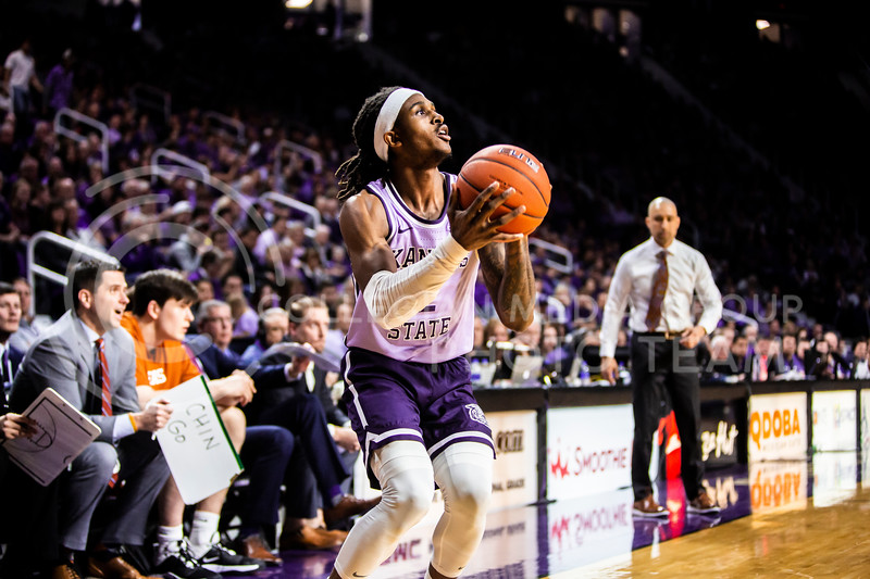 Junior guard Cartier Diarra prepares for a shot during K-State's men's basketball Throwback Game against Texas in Bramlage Coliseum on Feb. 22, 2020. For the Throwback Game, K-State wore two-tone lavender uniforms, which were worn from 1973 to 1982. The Longhorns took the Wildcats 70-59. (Logan Wassall | Collegian Media Group)