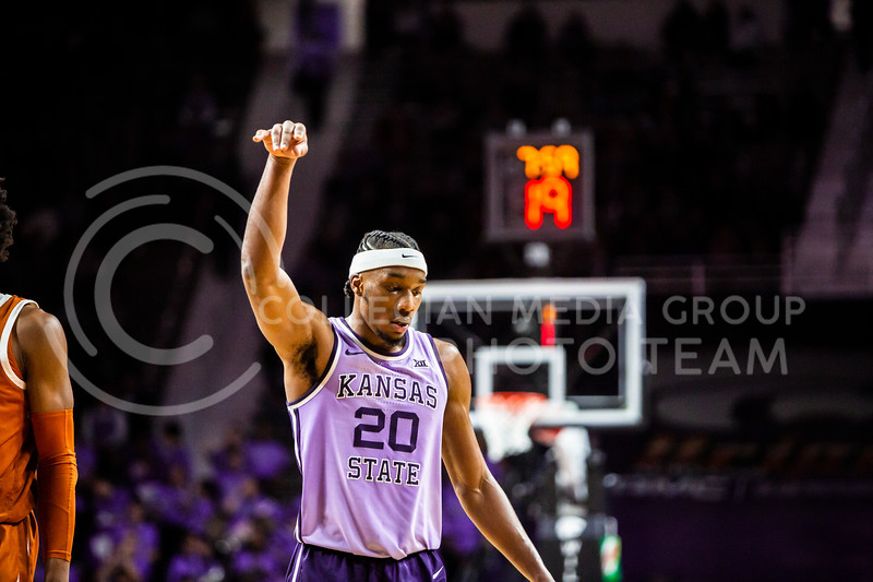 Senior forward Xavier Sneed celebrates after making a three-point-shot during K-State's men's basketball Throwback Game against Texas in Bramlage Coliseum on Feb. 22, 2020. For the Throwback Game, K-State wore two-tone lavender uniforms, which were worn from 1973 to 1982. The Longhorns took the Wildcats 70-59. (Logan Wassall | Collegian Media Group)
