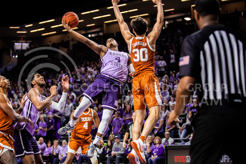 Junior guard David Sloan leaps towards the basket for a shot during K-State's men's basketball Throwback Game against Texas in Bramlage Coliseum on Feb. 22, 2020. For the Throwback Game, K-State wore two-tone lavender uniforms, which were worn from 1973 to 1982. The Longhorns took the Wildcats 70-59. (Logan Wassall | Collegian Media Group)