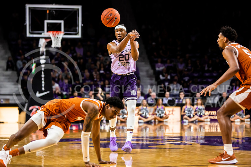 Senior forward Xavier Sneed passes the ball during K-State's men's basketball Throwback Game against Texas in Bramlage Coliseum on Feb. 22, 2020. For the Throwback Game, K-State wore two-tone lavender uniforms, which were worn from 1973 to 1982. The Longhorns took the Wildcats 70-59. (Logan Wassall | Collegian Media Group)