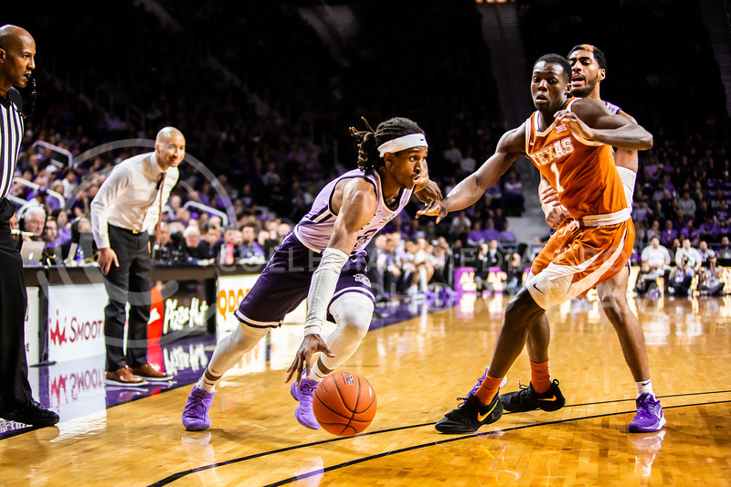 Junior guard Cartier Diarra charges the basket during K-State's men's basketball Throwback Game against Texas in Bramlage Coliseum on Feb. 22, 2020. For the Throwback Game, K-State wore two-tone lavender uniforms, which were worn from 1973 to 1982. The Longhorns took the Wildcats 70-59. (Logan Wassall | Collegian Media Group)