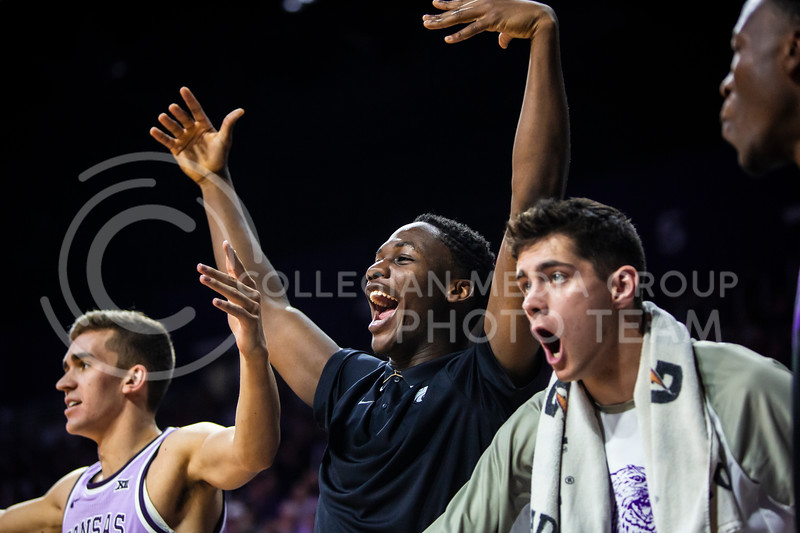 Freshman forward Montavious Murphy celebrates with his teammates on the bench during K-State's men's basketball Throwback Game against Texas in Bramlage Coliseum on Feb. 22, 2020. For the Throwback Game, K-State wore two-tone lavender uniforms, which were worn from 1973 to 1982. The Longhorns took the Wildcats 70-59. (Logan Wassall | Collegian Media Group)