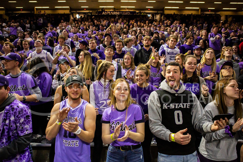 K-State fans cheer before their men's basketball Throwback Game against Texas in Bramlage Coliseum on Feb. 22, 2020. For the Throwback Game, K-State wore two-tone lavender uniforms, which were worn from 1973 to 1982. The Longhorns took the Wildcats 70-59. (Logan Wassall | Collegian Media Group)