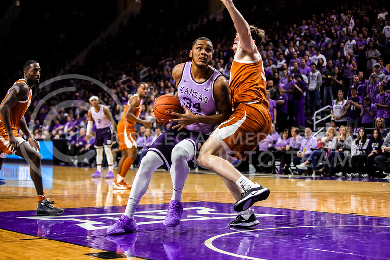 Junior forward Levi Stockard, III looks towards the basket for a play during K-State's men's basketball Throwback Game against Texas in Bramlage Coliseum on Feb. 22, 2020. For the Throwback Game, K-State wore two-tone lavender uniforms, which were worn from 1973 to 1982. The Longhorns took the Wildcats 70-59. (Logan Wassall | Collegian Media Group)