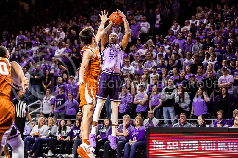 Senior forward Xavier Sneed leaps up for a shot during K-State's men's basketball Throwback Game against Texas in Bramlage Coliseum on Feb. 22, 2020. For the Throwback Game, K-State wore two-tone lavender uniforms, which were worn from 1973 to 1982. The Longhorns took the Wildcats 70-59. (Logan Wassall | Collegian Media Group)