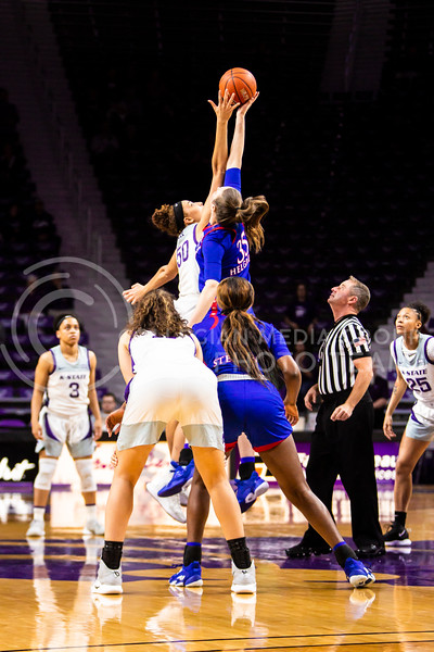 Freshman center Ayoka Lee leaps up for the tipoff during K-State's women's basketball team's Senior Day game against Kansas in Bramlage Coliseum on March 8, 2020. The Wildcats took the Jayhawks 83-63. After the game, K-State held a ceremony in honor of this year's three senior players. (Logan Wassall | Collegian Media Group)
