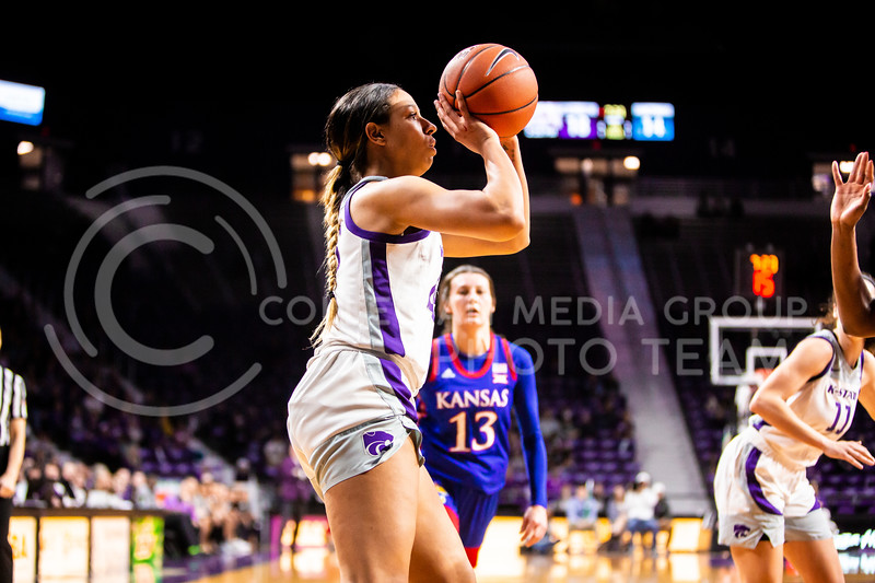 Sophomore guard Christianna Carr takes a shot during K-State's women's basketball team's Senior Day game against Kansas in Bramlage Coliseum on March 8, 2020. The Wildcats took the Jayhawks 83-63. After the game, K-State held a ceremony in honor of this year's three senior players. (Logan Wassall | Collegian Media Group)