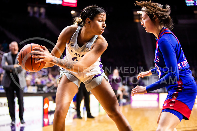 Sophomore guard Christianna Carr looks across the court for an open play during K-State's women's basketball team's Senior Day game against Kansas in Bramlage Coliseum on March 8, 2020. The Wildcats took the Jayhawks 83-63. After the game, K-State held a ceremony in honor of this year's three senior players. (Logan Wassall   Collegian Media Group)