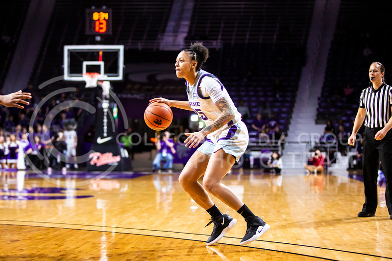 Senior forward Jasauen Beard scans the court for an open play during K-State's women's basketball team's Senior Day game against Kansas in Bramlage Coliseum on March 8, 2020. The Wildcats took the Jayhawks 83-63. After the game, K-State held a ceremony in honor of this year's three senior players. (Logan Wassall | Collegian Media Group)