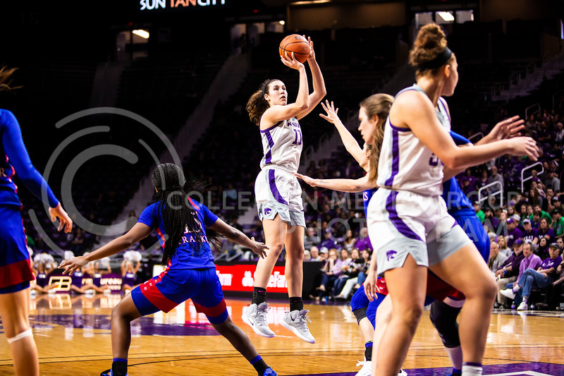 Senior forward Peyton Williams leaps up to take a shot during K-State's women's basketball team's Senior Day game against Kansas in Bramlage Coliseum on March 8, 2020. The Wildcats took the Jayhawks 83-63. After the game, K-State held a ceremony in honor of this year's three senior players. (Logan Wassall   Collegian Media Group)