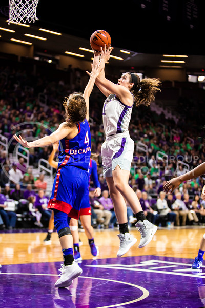 Senior forward Peyton Williams leaps up for a shot during K-State's women's basketball team's Senior Day game against Kansas in Bramlage Coliseum on March 8, 2020. The Wildcats took the Jayhawks 83-63. After the game, K-State held a ceremony in honor of this year's three senior players. (Logan Wassall | Collegian Media Group)