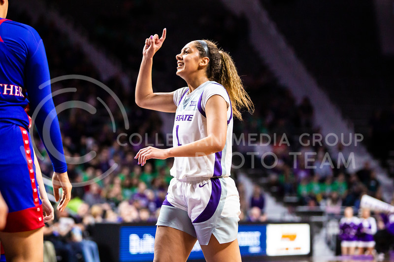 Sophomore guard Savannah Simmons celebrates after a play during K-State's women's basketball team's Senior Day game against Kansas in Bramlage Coliseum on March 8, 2020. The Wildcats took the Jayhawks 83-63. After the game, K-State held a ceremony in honor of this year's three senior players. (Logan Wassall   Collegian Media Group)
