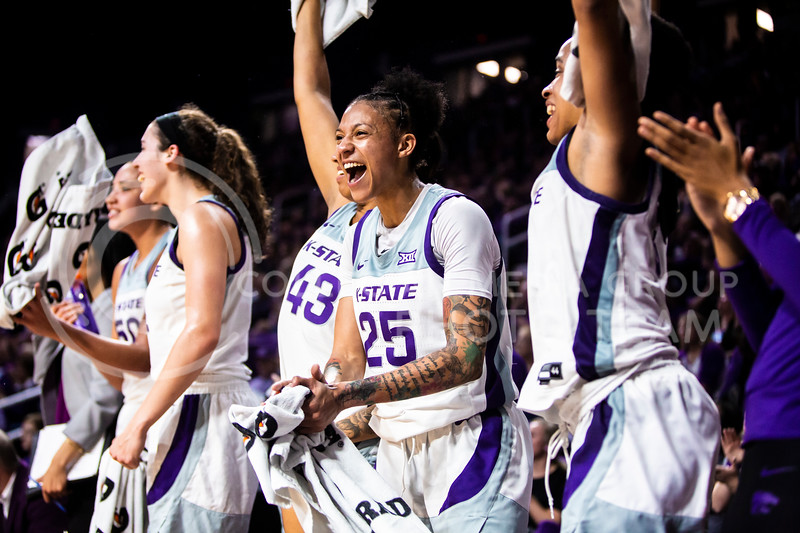 Senior forward Jasauen Beard celebrates with her teammates from the bench after a successful play during K-State's women's basketball team's Senior Day game against Kansas in Bramlage Coliseum on March 8, 2020. The Wildcats took the Jayhawks 83-63. After the game, K-State held a ceremony in honor of this year's three senior players. (Logan Wassall | Collegian Media Group)
