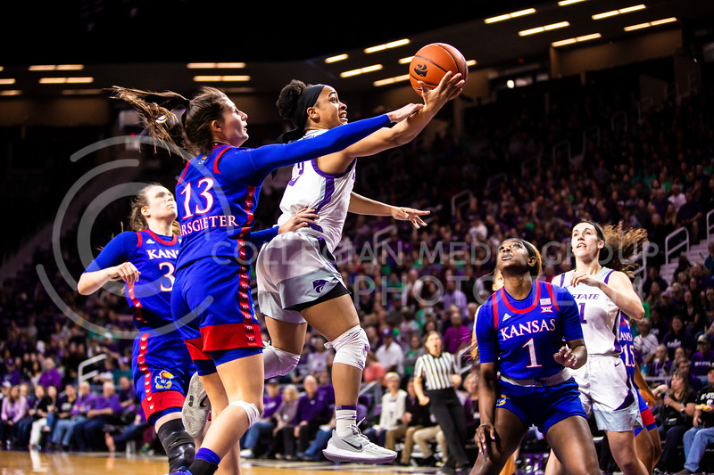 Senior guard Angela Harris charges the basket for a layup during K-State's women's basketball team's Senior Day game against Kansas in Bramlage Coliseum on March 8, 2020. The Wildcats took the Jayhawks 83-63. After the game, K-State held a ceremony in honor of this year's three senior players. (Logan Wassall | Collegian Media Group)
