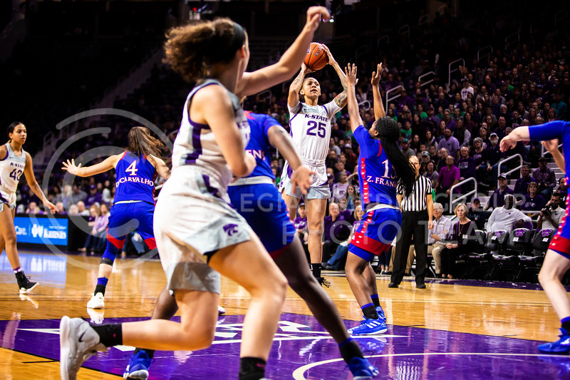 Senior forward Jasauen Beard leaps up for a shot during K-State's women's basketball team's Senior Day game against Kansas in Bramlage Coliseum on March 8, 2020. The Wildcats took the Jayhawks 83-63. After the game, K-State held a ceremony in honor of this year's three senior players. (Logan Wassall | Collegian Media Group)