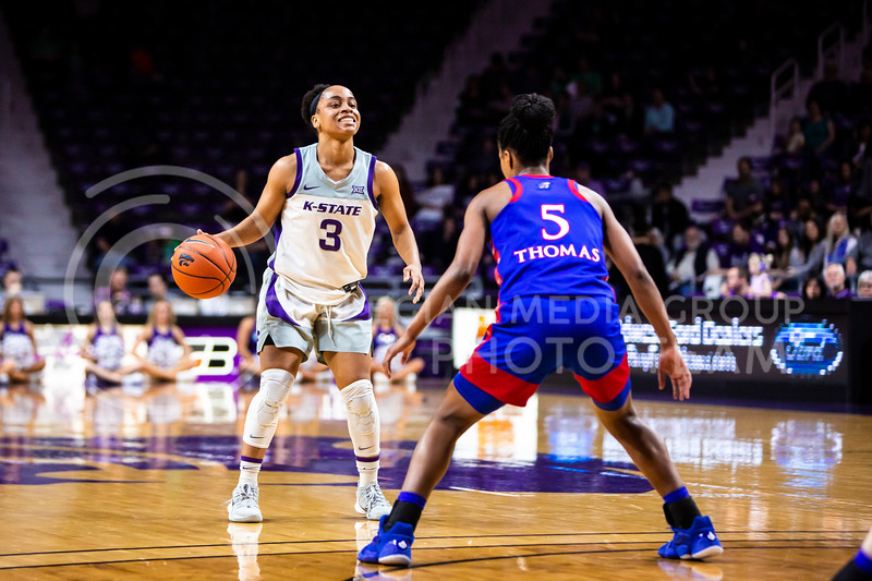 Senior guard Angela Harris scans the court for an open play during K-State's women's basketball team's Senior Day game against Kansas in Bramlage Coliseum on March 8, 2020. The Wildcats took the Jayhawks 83-63. After the game, K-State held a ceremony in honor of this year's three senior players. (Logan Wassall | Collegian Media Group)