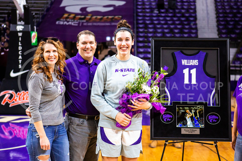 Senior forward Peyton Williams celebrates with her family during K-State's women's basketball team's Senior Day ceremony after their game against Kansas in Bramlage Coliseum on March 8, 2020. The Wildcats took the Jayhawks 83-63. (Logan Wassall | Collegian Media Group)