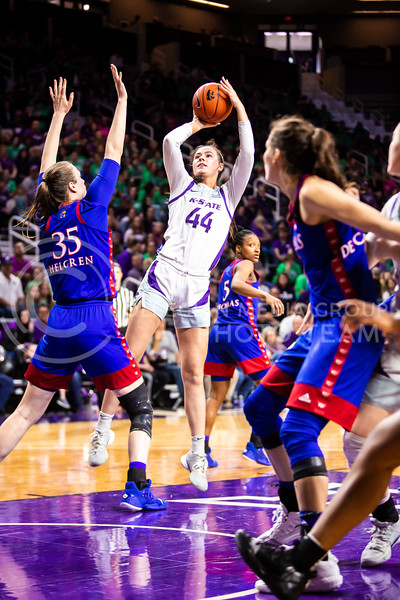 Freshman forward Emma Chapman leaps up for a shot during K-State's women's basketball team's Senior Day game against Kansas in Bramlage Coliseum on March 8, 2020. The Wildcats took the Jayhawks 83-63. After the game, K-State held a ceremony in honor of this year's three senior players. (Logan Wassall | Collegian Media Group)