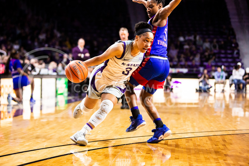 Senior guard Angela Harris charges the basket during K-State's women's basketball team's Senior Day game against Kansas in Bramlage Coliseum on March 8, 2020. The Wildcats took the Jayhawks 83-63. After the game, K-State held a ceremony in honor of this year's three senior players. (Logan Wassall | Collegian Media Group)