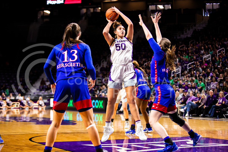 Freshman center Ayoka Lee leaps up for a shot during K-State's women's basketball team's Senior Day game against Kansas in Bramlage Coliseum on March 8, 2020. The Wildcats took the Jayhawks 83-63. After the game, K-State held a ceremony in honor of this year's three senior players. (Logan Wassall | Collegian Media Group)