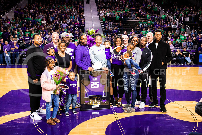Senior forward Jasauen Beard celebrates with her family during K-State's women's basketball team's Senior Day ceremony after their game against Kansas in Bramlage Coliseum on March 8, 2020. The Wildcats took the Jayhawks 83-63. (Logan Wassall | Collegian Media Group)