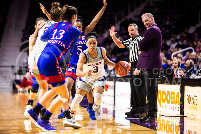 Senior guard Angela Harris drives down the court during K-State's women's basketball team's Senior Day game against Kansas in Bramlage Coliseum on March 8, 2020. The Wildcats took the Jayhawks 83-63. After the game, K-State held a ceremony in honor of this year's three senior players. (Logan Wassall | Collegian Media Group)