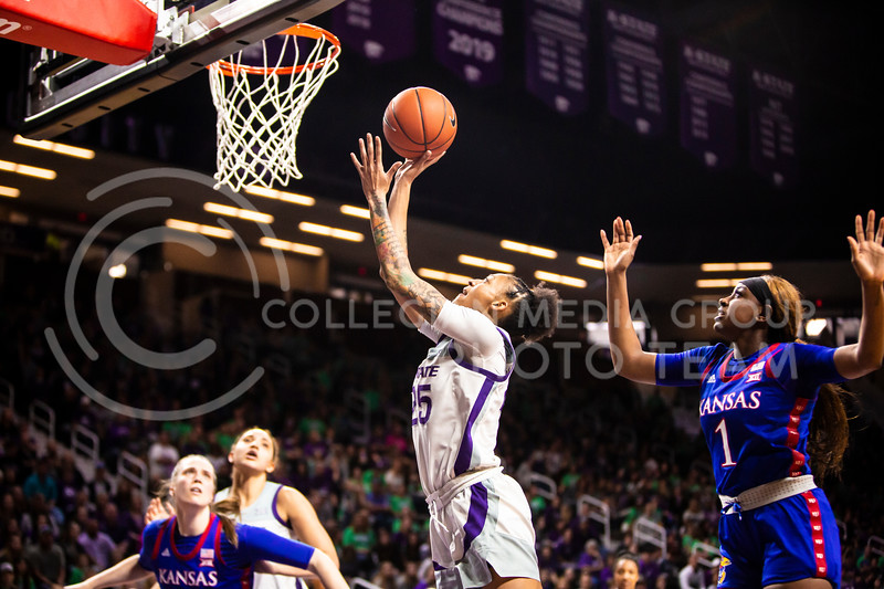 Senior forward Jasauen Beard charges the basket during K-State's women's basketball team's Senior Day game against Kansas in Bramlage Coliseum on March 8, 2020. The Wildcats took the Jayhawks 83-63. After the game, K-State held a ceremony in honor of this year's three senior players. (Logan Wassall | Collegian Media Group)
