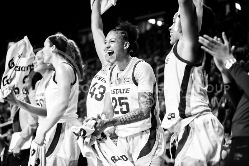 Senior forward Jasauen Beard celebrates with her teammates from the bench after a successful play during K-State's women's basketball team's Senior Day game against Kansas in Bramlage Coliseum on March 8, 2020. The Wildcats took the Jayhawks 83-63. After the game, K-State held a ceremony in honor of this year's three senior players. (Logan Wassall   Collegian Media Group)