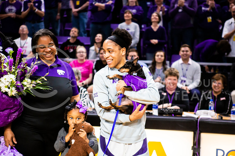 Senior guard Angela Harris celebrates with her family during K-State's women's basketball team's Senior Day ceremony after their game against Kansas in Bramlage Coliseum on March 8, 2020. The Wildcats took the Jayhawks 83-63. (Logan Wassall | Collegian Media Group)