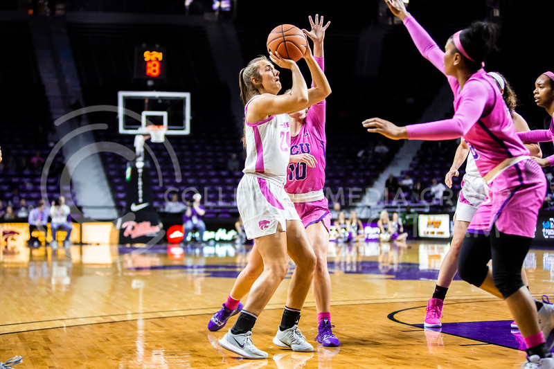 Freshman guard Emilee Ebert looks towards the basket for a shot during K-State's women's basketball team's Play 4 Kay Pink Game to promote cancer awareness. K-State played against TCU in Bramlage Coliseum on Feb. 19, 2020. The Horned Frogs defeated the Wildcats 54-52. (Logan Wassall | Collegian Media Group)