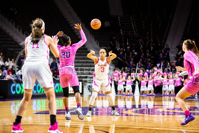 Senior guard Angela Harris passes the ball during K-State's women's basketball team's Play 4 Kay Pink Game to promote cancer awareness. K-State played against TCU in Bramlage Coliseum on Feb. 19, 2020. The Horned Frogs defeated the Wildcats 54-52. (Logan Wassall | Collegian Media Group)