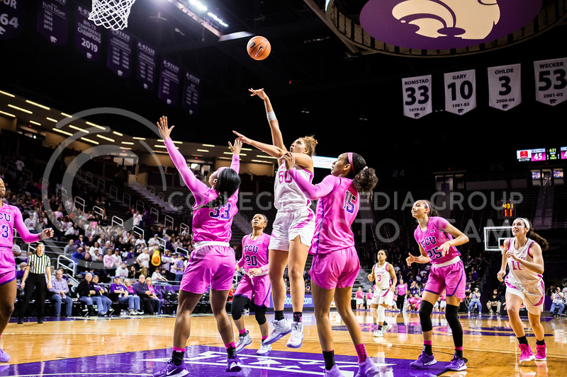 Freshman center Ayoka Lee leaps up for a shot during K-State's women's basketball team's Play 4 Kay Pink Game to promote cancer awareness. K-State played against TCU in Bramlage Coliseum on Feb. 19, 2020. The Horned Frogs defeated the Wildcats 54-52. (Logan Wassall | Collegian Media Group)